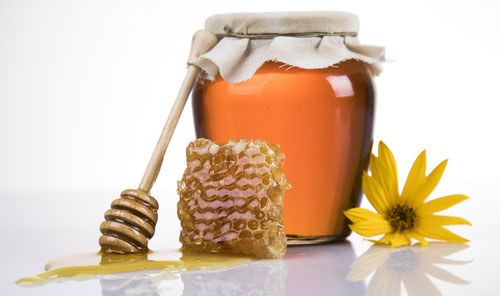 Apiary Friend, Valley View Farms, Jar of honey with yellow flower, honey comb, and honey spoon